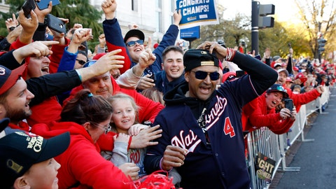 <p>               FILE - In this Nov. 2, 2019, file photo, Washington Nationals manager Dave Martinez celebrates with fans during a parade to celebrate the team's World Series baseball championship over the Houston Astros in Washington. Martinez says the World Series champs will raise their banner and present their rings at their stadium with fans in attendance -- no matter how or when or if the 2020 season starts. Like his general manager, Mike Rizzo, Martinez is optimistic there will be a major league season this year and has been mapping out what a second spring training camp might look like. (AP Photo/Patrick Semansky, File)             </p>