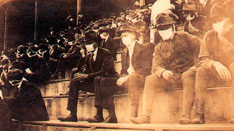<p>               This undated photo provided by Georgia Tech alumnus Andy McNeil shows a Georgia Tech home game during the 1918 college football season. The photo was taken by Georgia Tech student Thomas Carter, who would receive a degree in Mechanical Engineering. The 102-year-old photo could provide a snapshot of sports once live games resume: Fans packed in a campus stadium in the midst of a pandemic wearing masks with a smidge of social distance between them on concrete seats. (Thomas Carter via AP)             </p>