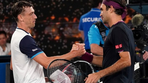 <p>               FILE - In this Jan. 25, 2020, file photo, Australia's John Millman, left, shakes hands with Switzerland's Roger Federer following their match at the Australian Open tennis championship in Melbourne, Australia. Just four matches after his five-setter against Federer on one of the biggest stages in tennis, Millman was having to scramble to find a practice court. (AP Photo/Lee Jin-man, File)             </p>