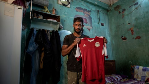 <p>               In this May 9, 2020 photo, 28-year-old defender Mahrous Mahmoud holds up his Egyptian national football team jersey he trains with, inside his home, in Manfalut, a town 350 kilometers (230 miles) south of Cairo in the province of Assiut, Egypt. Mahmoud should be on the field at this time of year playing as a defender for Beni Suef, a club in Egypt's second division. But like millions in the Arab world's most populous country, he has been hit hard by the coronavirus pandemic. (AP Photo/Nariman El-Mofty)             </p>