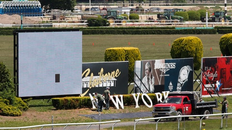 """<p>               Workers place letters spelling out '""""New York"""" on the infield at Belmont Race Track as they prepare for the 2020 Belmont Stakes race, which this year will be the first leg of horse racing's Triple Crown, Wednesday, May 27, 2020, as Phase One reopening plans were put into action in Elmont, N.Y. Belmont is usually the last leg of horse racing's Triple Crown, but this year it will be held first. Normally held in early June, the race has been rescheduled to June 20, 2020, and will be run without spectators in attendance. (AP Photo/Kathy Willens)             </p>"""