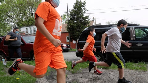 <p>               Brothers Victor Ochoa, 7, right, Jesus Ochoa, 5, second from right, Mariano Ochoa 9, second from left, and their mother Mariana Ochoa run in front of their home in Chicago, Friday, May 22, 2020.  Chicago Run's at-home fitness programs have become an essential part of the family's routine during the coronavirus pandemic. (AP Photo/Nam Y. Huh)             </p>