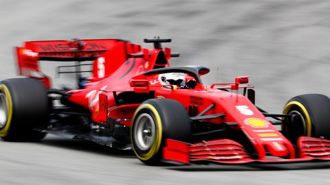<p>               Ferrari driver Sebastian Vettel of Germany steers through a corner during the Formula One pre-season testing session at the Barcelona Catalunya racetrack in Montmelo, outside Barcelona, Spain, Thursday, Feb. 27, 2020. (AP Photo/Joan Monfort)             </p>