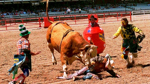 <p>               FILE - In this July, 1997 file photo, Dwayne Hargo, left, Rick Chatman, right, and Quail Dobbs, in the barrel, try to divert the bull's attention away from a fallen cowboy at the Frontier Days rodeo in Cheyenne, Wyo. Cheyenne Frontier Days has been canceled for the first time in its 124-year history due to the coronavirus. Cheyenne Mayor Marian Orr said Wednesday, May 27, 2020 that organizers decided the risk of spreading the virus was too great for the more than 140,000 people who visit Cheyenne for Frontier Days in late July. (AP Photo/Ed Bailey, File)             </p>