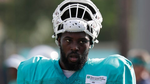<p>               FILE - In this July 30, 2018, file photo, Miami Dolphins defensive end Charles Harris (90) walks on the field at the NFL football team's training camp in Davie, Fla. Former first-round draft pick Charles Harris was traded Friday, May 1, 2020, after three unproductive seasons by the Miami Dolphins to the Atlanta Falcons for a seventh-round choice in 2021. (AP Photo/Lynne Sladky, File)             </p>