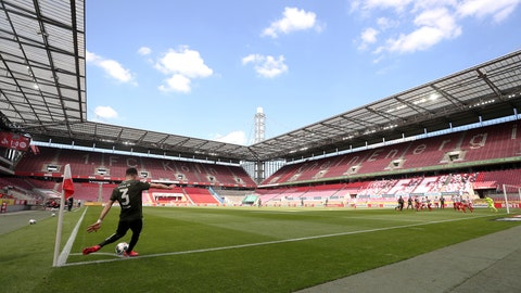 <p>               Aaron of FSV Mainz 05 takes a corner kick during the German Bundesliga soccer match between 1. FC Cologne and FSV Mainz 05 in Cologne, Germany, Sunday, May 17, 2020. The German Bundesliga is the world's first major soccer league to resume after a two-month suspension because of the coronavirus pandemic. (AP Photo/Lars Baron, Pool)             </p>