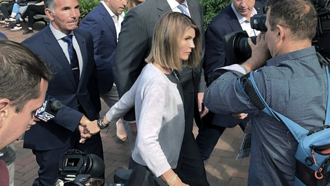 <p>               FILE - In this Aug. 27, 2019, file photo, Lori Loughlin departs federal court with her husband, clothing designer Mossimo Giannulli, left, in Boston, after a hearing in a nationwide college admissions bribery scandal. Loughlin and Giannulli have agreed to plead guilty in a video arraignment scheduled for Friday, May 22, 2020, to charges of trying to secure the fraudulent admission of their two children to the University of Southern California as purported athletic recruits. (AP Photo/Philip Marcelo, File)             </p>