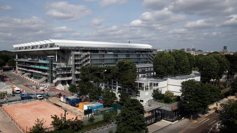 <p>               The Philippe-Chatrier tennis court with its retractable roof is pictured from a top building in Paris, Sunday, May 24, 2020 as the Roland Garros tournament is posponed. It should have been the first day of the French Open tennis tournament, with thousands of fans flocking to Roland Garros in western Paris hoping to catch a glimpse of 12-time champion Rafael Nadal or No. 1 Novak Djokovic. Instead, the grounds are deserted amid the coronavirus pandemic, with the famed tennis tournament on hold until late September. (AP Photo/Francois Mori)             </p>