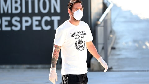 <p>               In this photo provided by FC Barcelona, Lionel Messi walks wearing a protective face mask at the club's training ground in Barcelona, Spain, on Wednesday May 6, 2020.  Soccer players in Spain returned to their team's training camps Wednesday for the first time since the country entered a lockdown nearly two months ago because of the coronavirus pandemic. Players for Barcelona, Real Madrid, Atlético Madrid and other clubs started preparing for the return to training this week, and they were all expected to be tested for COVID-19 and should be cleared to practice once the results are back. (Miguel Ruiz / FC Barcelona via AP)             </p>