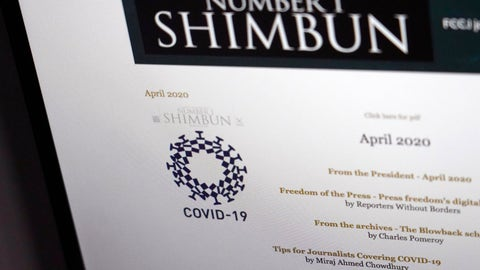 <p>               This website photo shows the cover design, left, of Number 1 Shimbun on its online edition, Tuesday, May 19, 2020. Tokyo Olympics officials are incensed that their games emblem has been used in the cover design of the local magazine that combines the logo with the novel coronavirus. (AP Photo/Shuji Kajiyama)             </p>