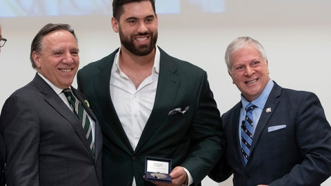 <p>               Kansas City Chiefs' Laurent Duvernay-Tardif, center, receives the National Assembly of Quebec Medal of Honour from Speaker Francois Paradis, right, while Quebec Premier Francois Legault, left, looks on, Tuesday, Feb. 18, 2020 at the legislature in Quebec City, Quebec. (Jacques Boissinot/The Canadian Press via AP)             </p>