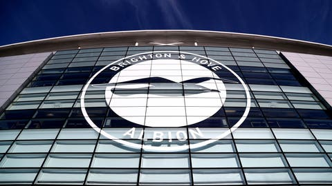 <p>               FILE - This Jan, 18, 2020 file photo shows a general view of the club crest on the side of the AMEX Stadium, home to Brighton & Hove Albion, Brighton, England. A Brighton player tested positive for the coronavirus as Premier League clubs prepare for talks on Monday, May 11 about how to resume the competition during the pandemic. The southern England club told The Associated Press there is no need for other members of the squad or coaches to self-isolate because players have only worked in isolation when at the training base. (Gareth Fuller/PA via AP, file)             </p>