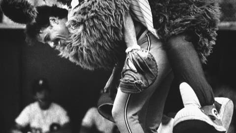 <p>               FILE - In this July 12, 1983, file photo, the Phillie Phanatic jumps onto the back of Atlanta Braves catcher Biff Pocoroba, who didn't see the Phillies mascot coming a warmup before a baseball doubleheader in Philadelphia. Pocoroba, who played in the 1978 All-Star Game and was a backup on the Braves team that won an improbable NL West title in 1982, has died at age 66. (AP Photo/Rusty Kennedy, File)             </p>