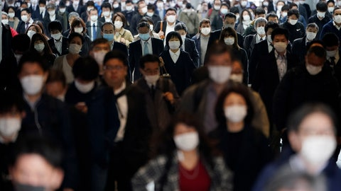 """<p>               FILE - In this April 27, 2020, file photo, a station passageway is crowded with commuters wearing face mask in Tokyo. Tokyo Olympic CEO Toshiro Muto talked Thursday, May 21, about the need to take """"countermeasures"""" to combat COVID-19 at next year's postponed games. (AP Photo/Eugene Hoshiko, File)             </p>"""