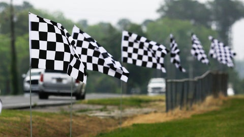 <p>               Checkered flags line a street outside Darlington Raceway Sunday, May 17, 2020, in Darlington, S.C. NASCAR, which has been idle since March 8 because of the coronavirus pandemic, makes its return with the Real Heroes 400 Nascar Cup Series auto race Sunday. (AP Photo/Brynn Anderson)             </p>