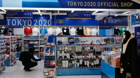 <p>               In this Jan. 8, 2020, file photo, a man looks at Olympic souvenirs at a Tokyo 2020 official shop in the Shinjuku district of Tokyo. Official Tokyo Olympic souvenir shops are drawing few customers these days. The pandemic and the fact the Olympics have been postponed for a year has wiped out almost all business. (AP Photo/Jae C. Hong, File)             </p>
