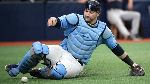 <p>               FILE - In this Sept. 22, 2019, file photo, Tampa Bay Rays catcher Mike Zunino slides to pick up a wild pitch from relief pitcher Andrew Kittredge during the fourth inning of a baseball game in St. Petersburg, Fla. Making it safe for America's professional sports teams to start playing games is one thing. Making sure athletes are in game shape is another. Experts say nothing should be rushed. Athletes in the NBA, NHL and Major League Baseball all indicate that a few weeks of training is necessary before any games. (AP Photo/Phelan M. Ebenhack, File)             </p>