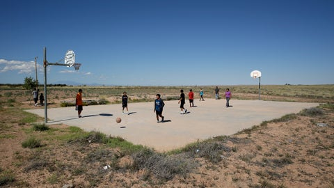 <p>               FILE - In this Sept. 25, 2014, file photo, students play basketball at Little Singer Community School in Birdsprings, Ariz., on the Navajo Nation. Basketball is woven in the fabric of Native American life. Now, during a global pandemic, the balls have all but stopped bouncing. Already hit hard by the coronavirus outbreak, Native Americans are faced with life without basketball — or any other sport - for the forseeable future. (AP Photo/John Locher, File)             </p>