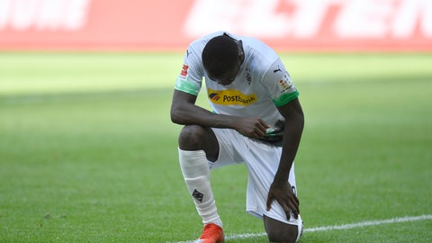 <p>               Moenchengladbach's Marcus Thuram reacts after scoring his side's second goal during the German Bundesliga soccer match between Borussia Moenchengladbach and Union Berlin in Moenchengladbach, Germany, Sunday, May 31, 2020. The German Bundesliga becomes the world's first major soccer league to resume after a two-month suspension because of the coronavirus pandemic. (AP Photo/Martin Meissner, Pool)             </p>