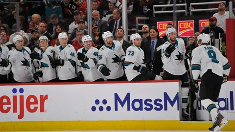 <p>               FILE - In this March 11, 2020, file photo, San Jose Sharks' Evander Kane (9) celebrates with teammates on the bench after scoring a goal during the first period of an NHL hockey game against the Chicago Blackhawks in Chicago. The Sharks had started planning for next season long before the news became official that they would be one of the seven teams left home if the NHL resumes its season. (AP Photo/Paul Beaty, File)             </p>
