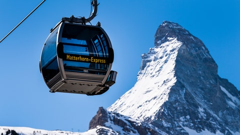 <p>               The 'Matterhorn-Express' gondola lift is pictured in front of Matterhorn mountain in the ski resort Zermatt, Switzerland, Wednesday, March 18, 2020. On March 16 the Swiss authorities proclaimed a state of emergency until April 19, 2020 in an effort to halt the spread of the coronavirus and Covid-19 disease. For most people, the new coronavirus causes only mild or moderate symptoms, such as fever and cough. For some, especially older adults and people with existing health problems, it can cause more severe illness, including pneumonia. (Jean-Christophe Bott/Keystone via AP)             </p>