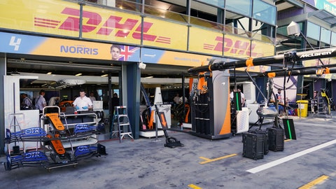 <p>               Technicians work around equipment and car parts in the The McLaren team pit at the Australian Formula One Grand Prix in Melbourne, Thursday, March 12, 2020. McLaren says it has withdrawn from the season-opening Australian Grand Prix in Melbourne after a team member tested positive for the coronavirus. (Michael Dodge/AAP Image via AP)             </p>