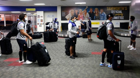 <p>               Players from the New Zealand Warriors of the National Rugby League arrive at the airport in  Tamworth, Australia, Sunday, May 3, 2020. After a 14-day isolation period during which they'll be able to train at Tamworth in the northwestern part of the state, they'll likely move down to the Central Coast north of Sydney and play most of their matches in that area once the planned resumption of the season on May 28. (Darren Pateman/AAP Image via AP)             </p>