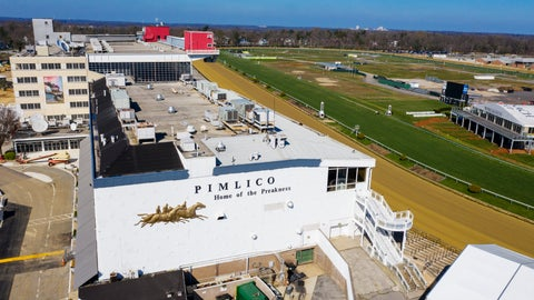 <p>               FILE - In this March 26, 2020, file photo, tractors groom the racing surface at the Pimlico Race Track in Baltimore, Md. The Preakness will remain at Pimlico Race Course into the foreseeable future, thanks to the passing of a bill to redevelop Maryland's race tracks with $375 million in bonds. (AP Photo/Steve Helber, File)             </p>