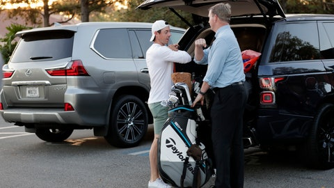 <p>               Rory McIlroy, left, bumps elbows with an official as he packs his vehicle after the PGA tour canceled the rest of The Players Championship golf tournament as a result of the coronavirus pandemic, Friday, March 13, 2020, in Ponte Vedra Beach, Fla. The PGA Tour first said there would be no fans. Now there will be no players. In a late Thursday night decision, the PGA Tour canceled the rest of The Players Championship and said it would not play the next three weeks. (AP Photo/Lynne Sladky)             </p>