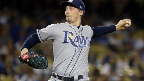 """<p>               FILE - In this Sept. 17, 2019, file photo, Tampa Bay Rays starting pitcher Blake Snell throws to a Los Angeles Dodgers batter during the first inning of a baseball game in Los Angeles. Rays All-Star pitcher Blake Snell says he  will not take the mound this year if his pay is cut further, proclaiming: """"I'm not playing unless I get mine."""" the 2018 AL Cy Young Award winner said on a Twitch stream Wednesday, May 14 2020. (AP Photo/Chris Carlson, File)             </p>"""