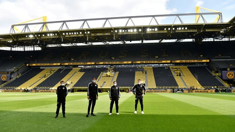 <p>               Referee Deniz Aytekin, 2nd left, and his team stand on the pitch before the German Bundesliga soccer match between Borussia Dortmund and Schalke 04 in Dortmund, Germany, Saturday, May 16, 2020. The German Bundesliga becomes the world's first major soccer league to resume after a two-month suspension because of the coronavirus pandemic. (AP Photo/Martin Meissner, Pool)             </p>