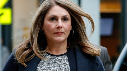 <p>               FILE - In this Feb. 25, 2020, file photo, Michelle Janavs arrives at federal court in Boston for sentencing in a nationwide college admissions bribery scandal. Lawyers for Janavs, who is supposed to report to prison in May, said in a legal filing Wednesday, April 22, 2020, that she should spend five months in home confinement instead of prison because she has an underlying health condition that makes her particularly vulnerable if she were to contract the coronavirus. (AP Photo/Elise Amendola, File)             </p>