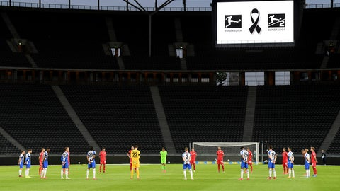 <p>               Players observe a minute's silence to commemorate the victims of the coronavirus pandemic prior to the German Bundesliga soccer match between Hertha BSC Berlin and 1. FC Union Berlin in Berlin, Germany, Friday, May 22, 2020. The German Bundesliga is the world's first major soccer league to resume after a two-month suspension because of the coronavirus pandemic. (Stuart Franklin/Pool Photo via AP)             </p>