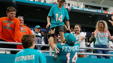 <p>               FILE - In this Dec. 1, 2019, file photo, Miami Dolphins quarterback Ryan Fitzpatrick (14) grabs his kids at the end of the second half at an NFL football game again st the Philadelphia Eagles in Miami Gardens, Fla. Ryan Fitzpatrick is spending his coronavirus lockdown in Arizona with his wife and seven children, and hoping to get a chance soon to begin mentoring first-round draft pick Tua Tagovailoa.(AP Photo/Brynn Anderson, File)             </p>