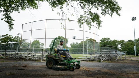 <p>               This April 22, 2020 photo, Memphis Little League President Kerry Cobb rides a lawn mover after cutting outfield grass at Will Carruthers Park in Memphis, Tenn. The city had shuttered its baseball program due to coronavirus concerns.  (Mark Weber/Daily Memphian via AP)             </p>