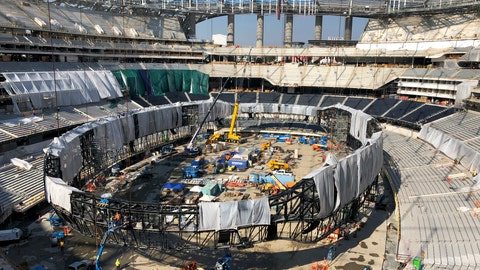<p>               In this Jan. 22, 2020, file photo, works continues on the interior of SoFi Stadium and preparing to raise the circular Oculus video board in Inglewood, Calif. The opening of the stadium on Sept. 13 has the Los Angeles Rams hosting the Dallas Cowboys in an NFL football game. (AP Photo/Greg Beacham, File)             </p>