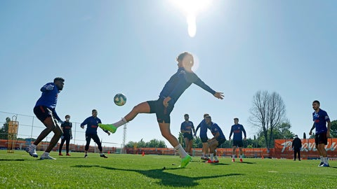 <p>               In this photo provided by Atletico Madrid, team players take part in the first group training session in Madrid, Spain, Monday May 18, 2020. All Spanish league clubs can begin group training sessions this week despite stricter lockdown restrictions remaining in place in parts of Spain because of the coronavirus pandemic. (Atletico de Madrid via AP)             </p>