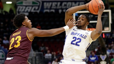 <p>               FILE - In this March 15, 2019, file photo, Buffalo's Dontay Caruthers (22) looks to pass as Central Michigan's Dallas Morgan (23) defends during the first half of an NCAA college basketball game in the semifinals of the Mid-American Conference men's tournament in Cleveland. The Mid-American Conference is eliminating postseason tournaments in eight sports, including baseball and softball, and men's and women's basketball are among nine sports that will have postseasons scaled back. The MAC's announced the cost-cutting move Tuesday in response to the financial crisis being brought on by the coronavirus pandemic. (AP Photo/Tony Dejak, File)             </p>