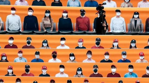 <p>               A TV cameraman walks through the spectators' seats which are covered with pictures of fans, before the start of a regular season baseball game between Hanwha Eagles and SK Wyverns in Incheon, South Korea, Tuesday, May 5, 2020. South Korea's professional baseball league start its new season on May 5, initially without fans, following a postponement over the coronavirus. (AP Photo/Lee Jin-man)             </p>