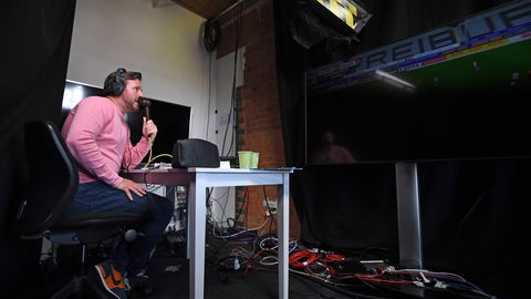 <p>               Soccer commentator Dan O'Hagan commentates on the German Bundesliga soccer match between Freiburg and Werder Bremen remotely from a studio in Camden Town, London, Saturday May 23, 2020. The Bundesliga is the only soccer major league to have resumed since the start of the coronavirus lockdown and with increased global demand matches are also being provided to customers with a commentary in English. (AP Photo/Alberto Pezzali)             </p>