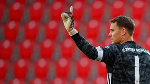 <p>               Munich's goal keeper Manuel Neuer gestures during the German Bundesliga soccer match between Union Berlin and Bayern Munich in Berlin, Germany, Sunday, May 17, 2020. The German Bundesliga becomes the world's first major soccer league to resume after a two-month suspension because of the coronavirus pandemic. (AP Photo/Hannibal Hanschke, Pool)             </p>