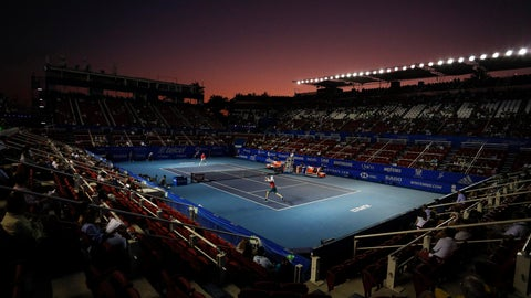 <p>               FILE - In this Feb. 28, 2020, file photo, John Isner of the U.S., front, returns a ball in his semifinal match against Taylor Fritz of the U.S. at the Mexican Tennis Open in Acapulco, Mexico. According to an email obtained by The Associated Press on Monday, May 4, the WTA and ATP professional tours, the groups that run the four Grand Slam tournaments and the International Tennis Federation are expected to establish eligibility rules that will factor in the players' rankings and past prize money earnings. (AP Photo/Rebecca Blackwell, File)             </p>