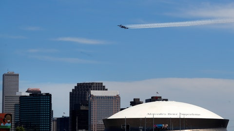 <p>               The Blue Angels, the U.S. Navy flight demonstration squadron, flies over downtown New Orleans and the Mercedes-Benz Superdome, as a salute to the health care front line responders working to help the sick during the coronavirus pandemic, Wednesday, May 6, 2020. (AP Photo/Gerald Herbert)             </p>