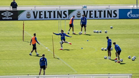 <p>               Players of Bundesliga soccer club Schalke 04 exercise in Gelsenkirchen, Germany, Thursday, May 14, 2020. Bundesliga will now restart on May 16, 2020 when Borussia Dortmund will play the derby against FC Schalke 04 at home without spectators due to the coronavirus outbreak. (AP Photo/Martin Meissner)             </p>