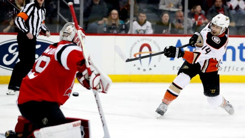 <p>               FILE - In this Dec. 18, 2019, file photo, Anaheim Ducks center Adam Henrique (14) scores a goal against New Jersey Devils goaltender Mackenzie Blackwood (29) during the first period of an NHL hockey game in Newark, N.J. Linemates Henrique and Jakob Silfverberg bucked their team's offensive struggles with a pair of impressive seasons, and they will be a foundation of the rebuilding effort. Henrique was particularly productive, leading the roster with 43 points. They are both locked into long-term contracts .(AP Photo/Kathy Willens, File)             </p>