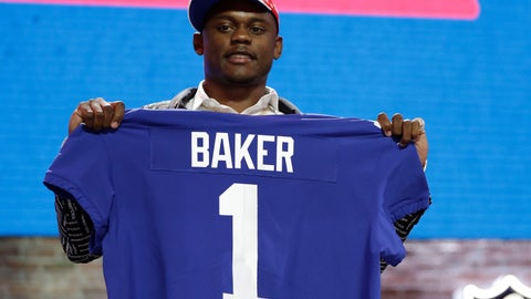 <p>               FILE - In this April 25, 2019, file photo, Georgia defensive back DeAndre Baker poses with his new jersey after the New York Giants selected him in the first round at the NFL football draft in Nashville, Tenn. Police in South Florida are trying to find Giants cornerback Baker and Seattle Seahawks cornerback Quinton Dunbar after multiple witnesses accused them of an armed robbery at a party. Miramar police issued arrest warrants for both men Thursday, May 14, 2020. (AP Photo/Mark Humphrey, File)             </p>