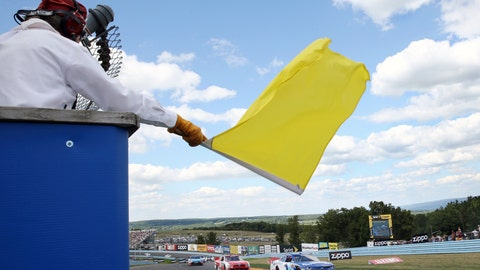 <p>               FILE - In this Aug. 6, 2016, file photo, a track marshall waves a yellow caution flag during a NASCAR Xfinity series auto race at Watkins Glen International in Watkins Glen, N.Y. As NASCAR speeds back to the race track during the coronavirus pandemic the series has a heavy responsibility to set a safety standard that doesn't slow the return of other sports. (AP Photo/Mel Evans, File)             </p>