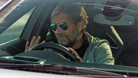 <p>               Liverpool soccer team manager Jurgen Klopp waves as he arrives at the club's Melwood training ground after the English Premier League announced players can return to training in small groups as the coronavirus lockdown is eased Wednesday May 20, 2020. (Peter Byrne/PA via AP)             </p>