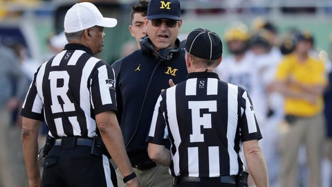 <p>               Michigan coach Jim Harbaugh talks with officials during the second half of the team's Citrus Bowl NCAA college football game against Alabama, Wednesday, Jan. 1, 2020, in Orlando, Fla. (AP Photo/John Raoux)             </p>