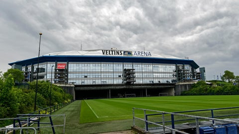 <p>               Rain clouds draw over the stadium Veltins Arena and the rolled out pitch of Bundesliga club FC Schalke 04 in Gelsenkirchen, Germany, Wednesday, April 29, 2020. Despite a ban in Germany on all large gatherings through the end of August to fight the coronavirus pandemic, soccer officials are hoping to restart the league without spectators in May. (AP Photo/Martin Meissner)             </p>